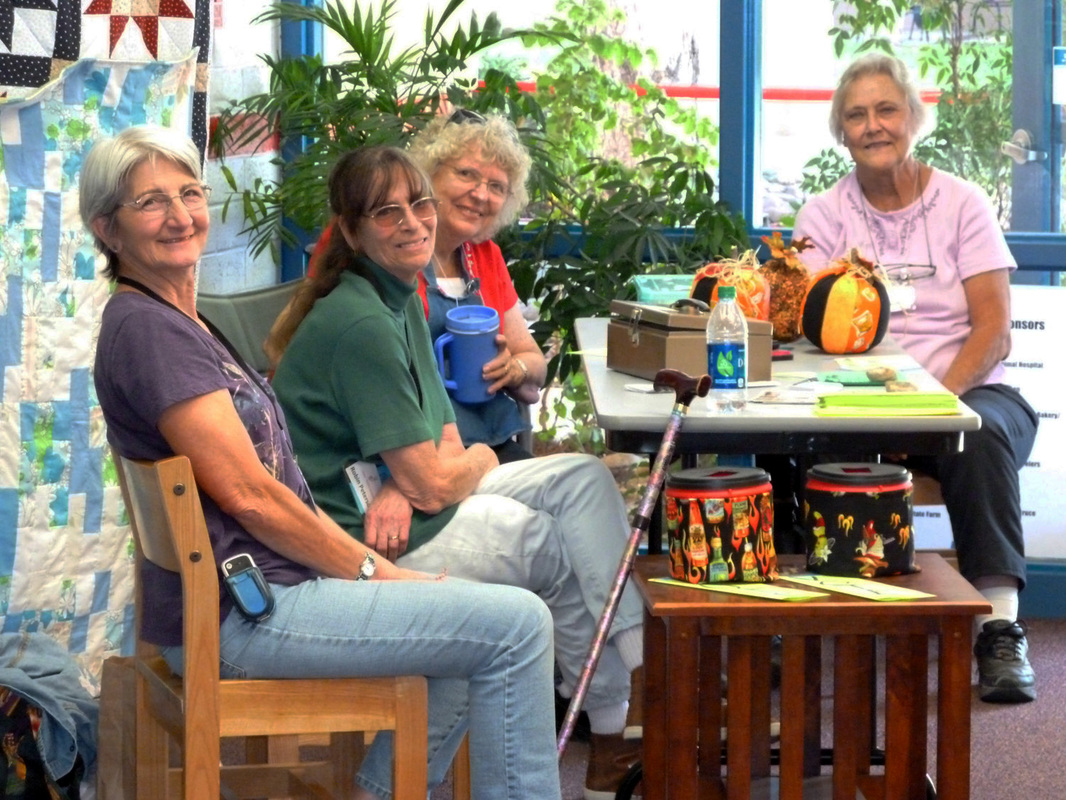 Chino Valley Quilters members greet visitors.