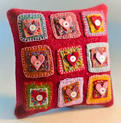 Picture of embellished hearts on pillow.